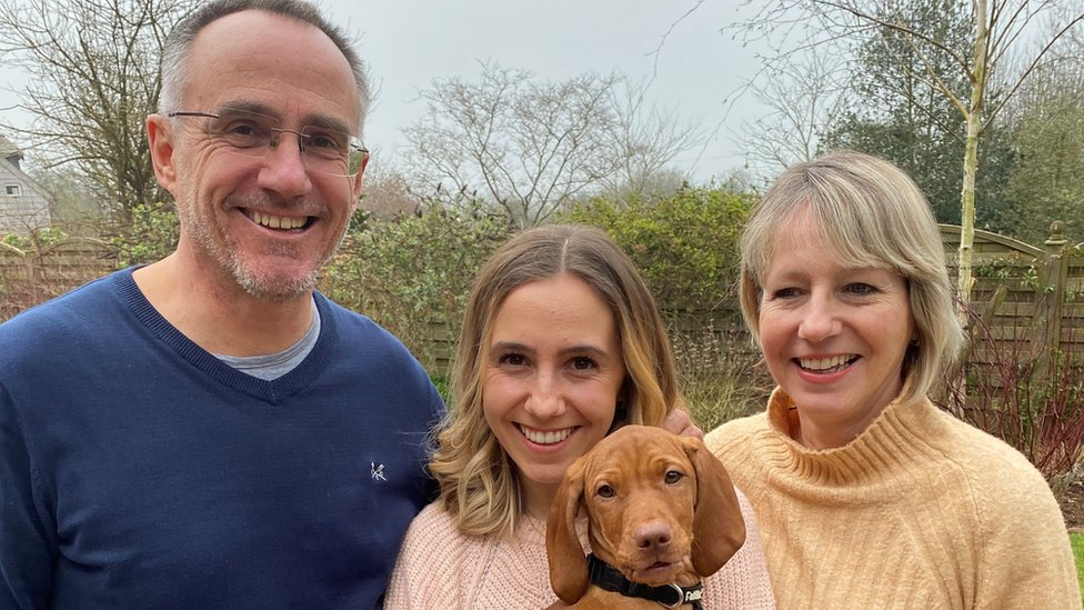 Mark Simmonds pictured with daughter Emily holding dog Peggy, and wife and business partner Mel, 57.