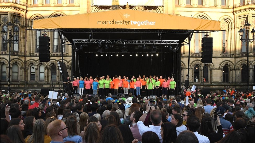 A choir on stage at Manchester Together
