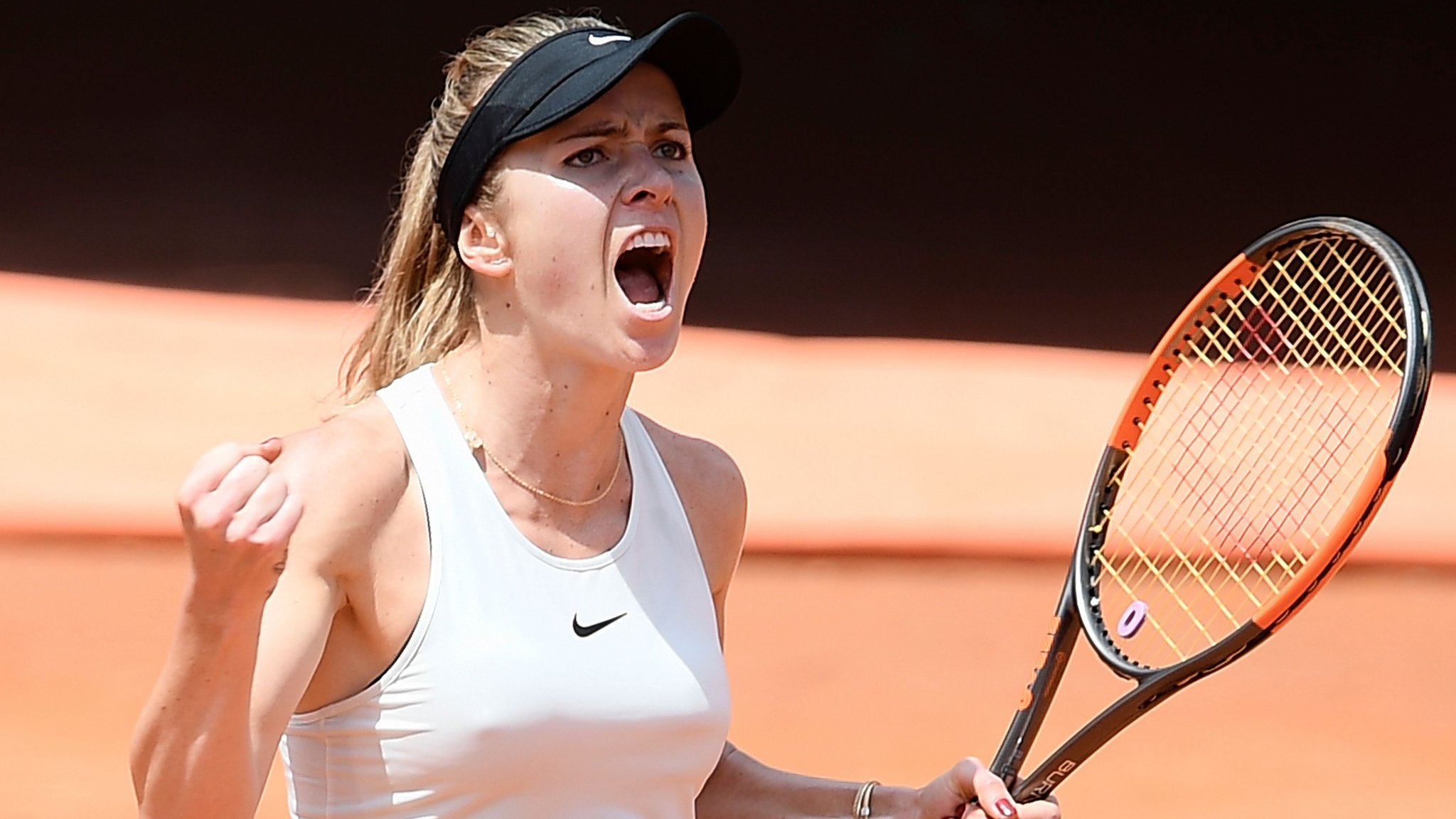 Svitolina overwhelms Halep to win Italian Open