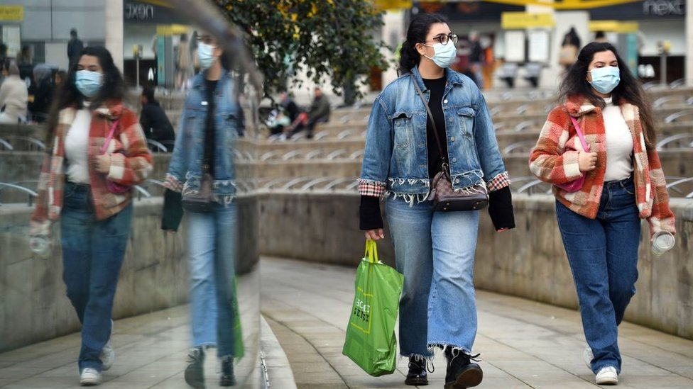 People wearing masks in Manchester city centre