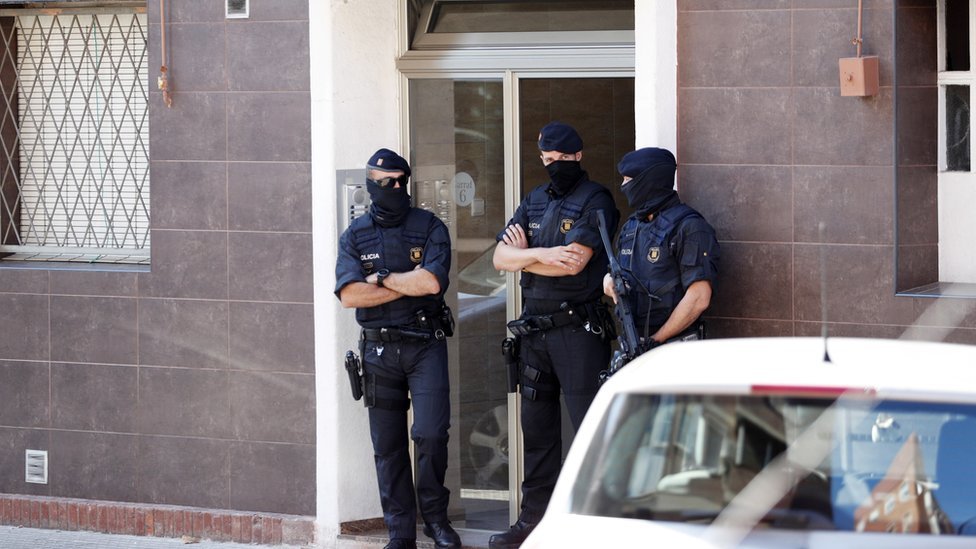 Police guard the home of an alleged attacker in Cornellà de Llobregat