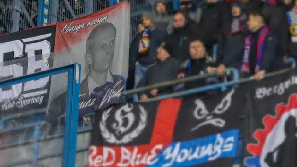 Fans displaying Walus banner