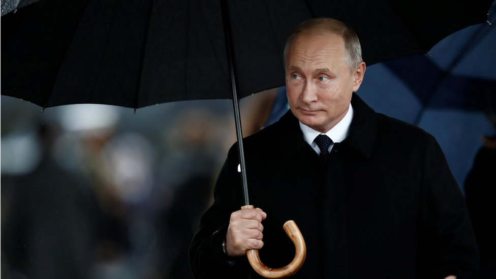 Russian President Vladimir Putin arrives to attend a commemoration ceremony for Armistice Day
