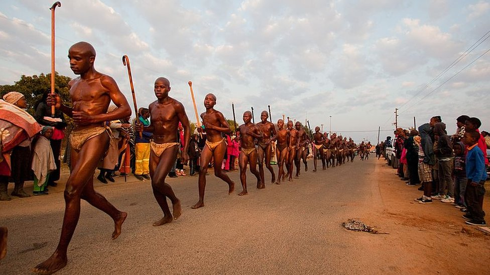 Ndebele initiates running and jumping the fire as part of the ritual during their home coming celebrations