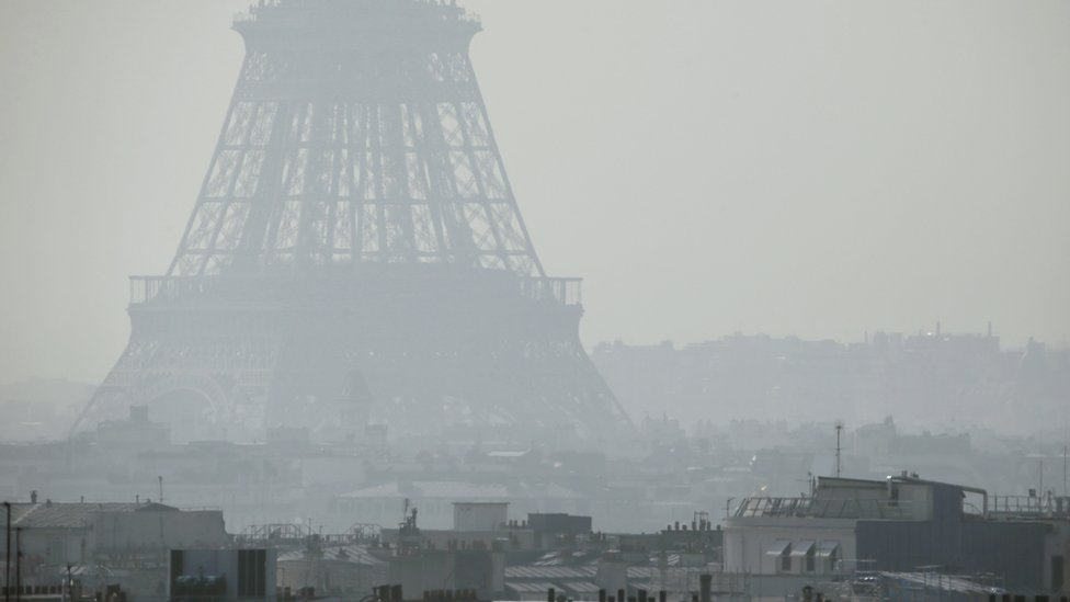 File pic of Eiffel Tower in thick smog in 2014