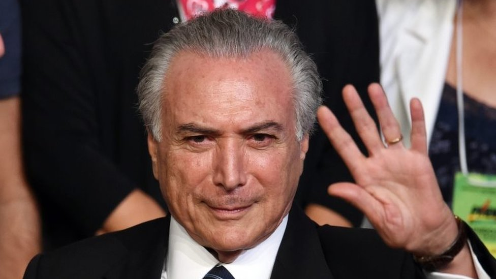 This file photo taken on March 12, 2016 shows Brazilian Vice President Michel Temer waving during the Brazilian Democratic Movement Party (PMDB) national convention in Brasilia, on March 12, 2016.