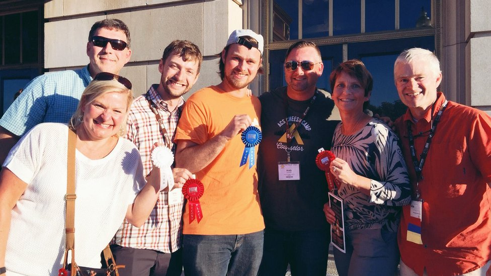 Britton Welsh, third left, with others at 'cheese camp' holding their awards