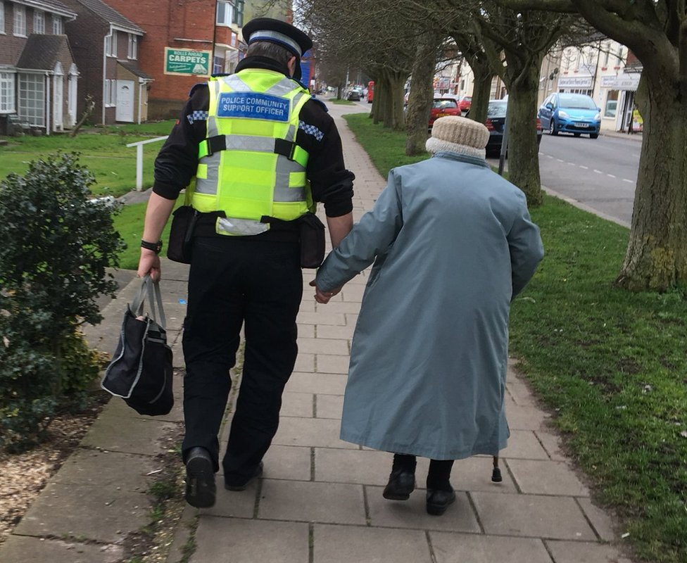 PCSO Dave Bunker helps and elderly woman