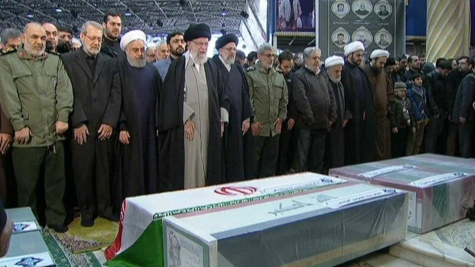 Ayatollah Khamenei leads prayers by the coffin of Qasem Soleimani