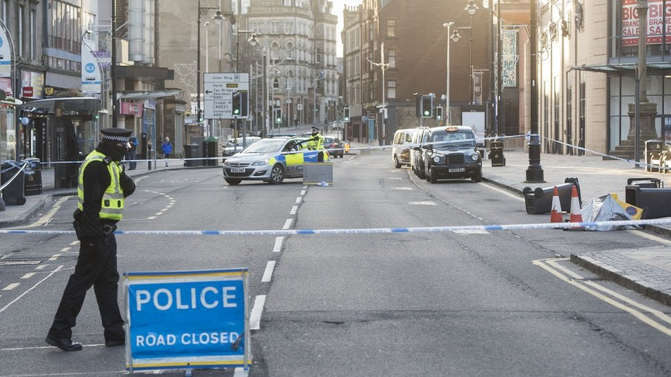 Police tape cordons off part of Dundee's Nethergate.