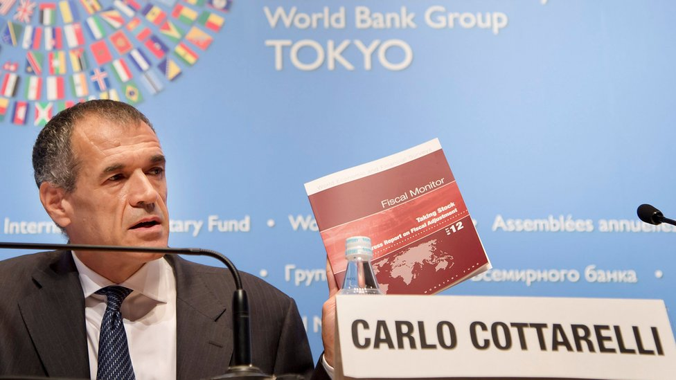 Carlo Cottarelli holds a news briefing on the Fiscal Monitor at the Tokyo International Forum in Tokyo, 9 October 2012.