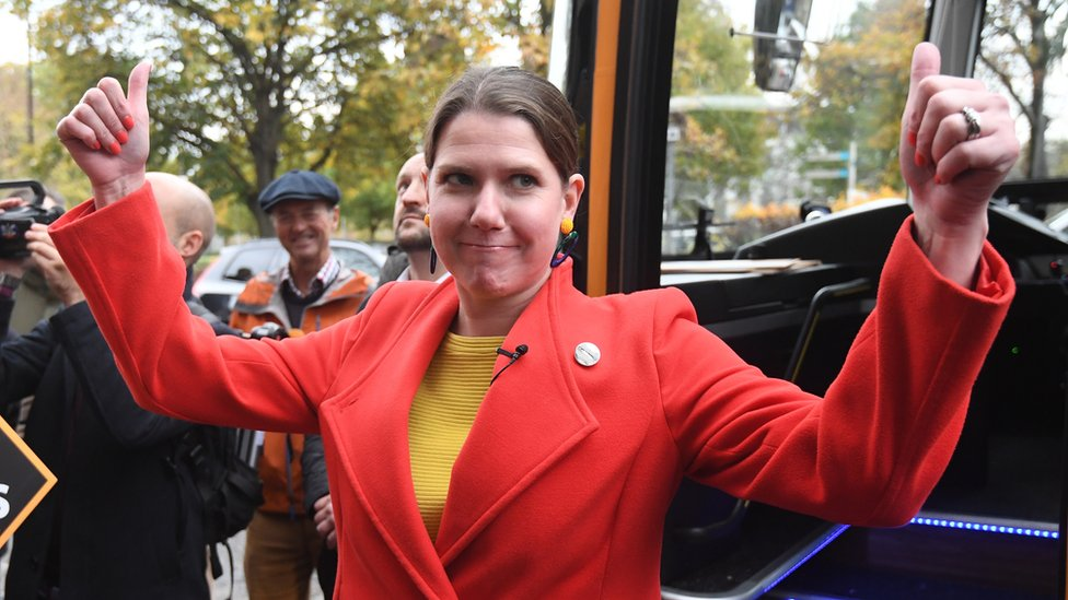 Liberal Democrat leader Jo Swinson greets supporters as she arrives on the battle bus during a campaign visit to cafe Amisha in South Bermondsey in London, Britain