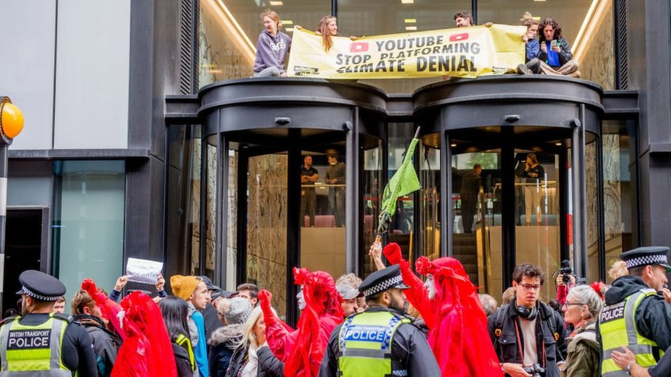 Extinction Rebellion on top of YouTube building
