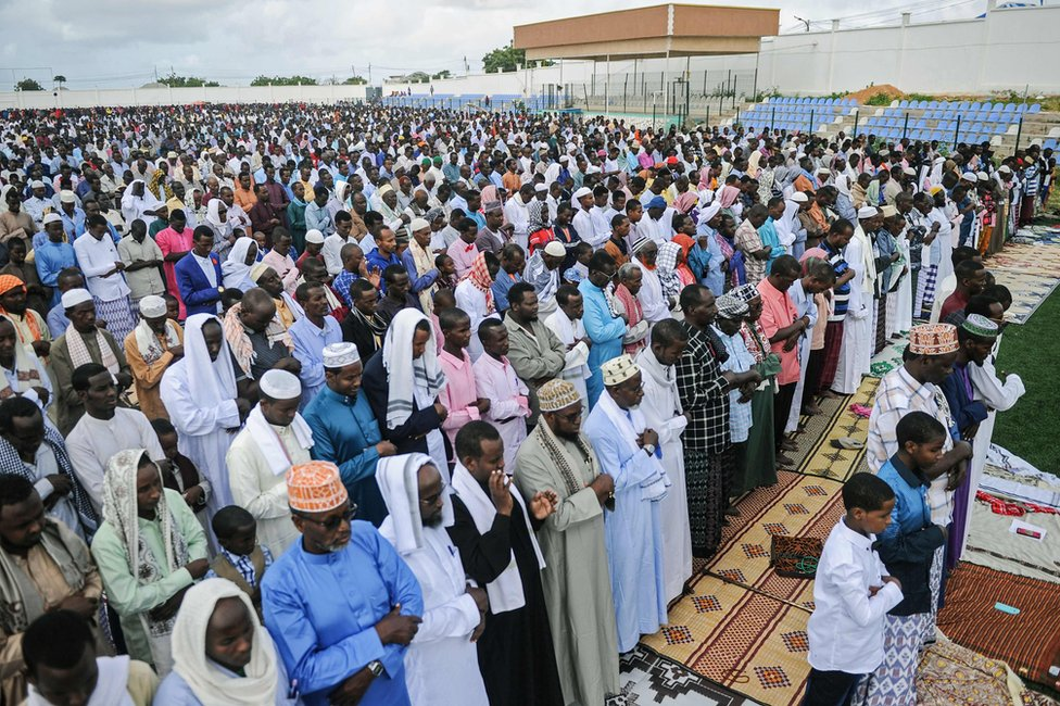 Somali Muslims take part in Eid al-Fitr prayer which marks the end of the holy month of Ramadan at the football pitch of the Jamacadaha stadium in Mogadishu, on June 15, 2018