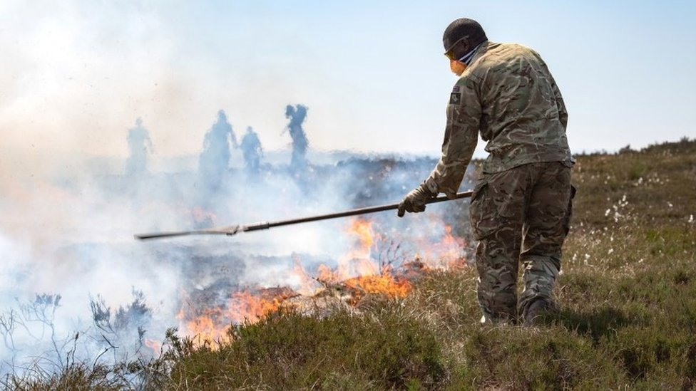 The military and firefighters tackle a wildfire near Saddleworth Moor