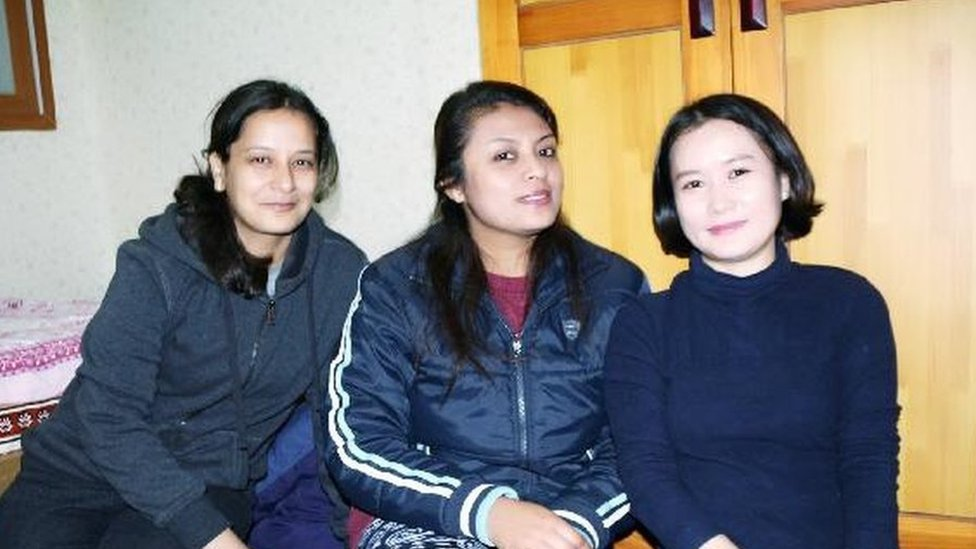 Kim Hana with two other Nepalese students.