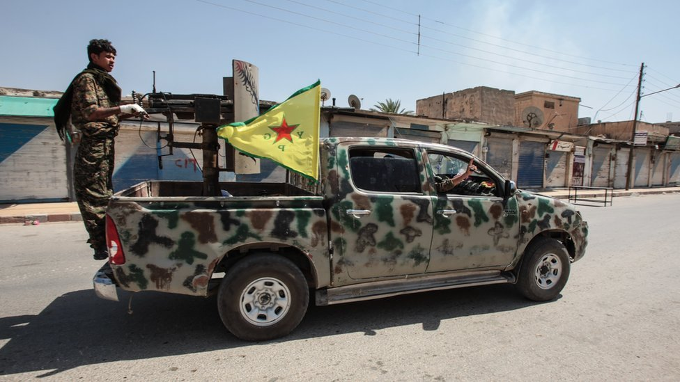 Kurdish People's Protection Units, or YPG fighters control downtown of Tal Abyad, Syria, June 2015