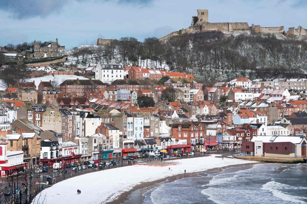 Snow covers the beach in the sea side resort of Scarborough in North Yorkshire