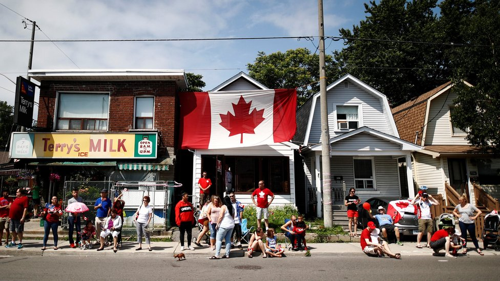 A house is covered in a huge Canadian flag in Toronto