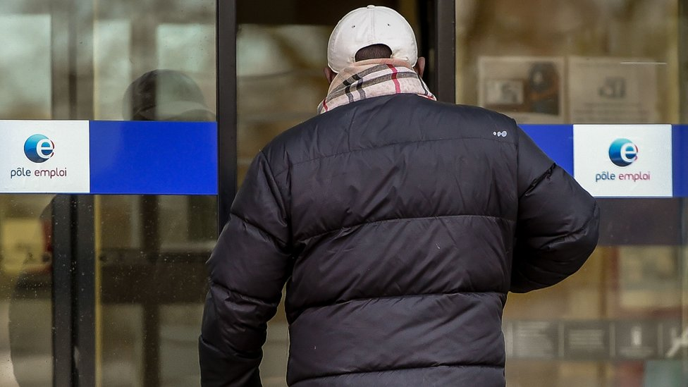 File pic of man entering Pôle emploi agency in France