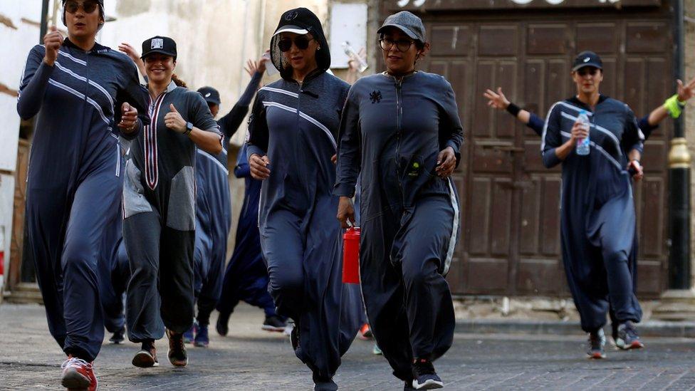 Women run during an event marking International Women's Day in Old Jeddah, Saudi Arabia on 8 March 2018