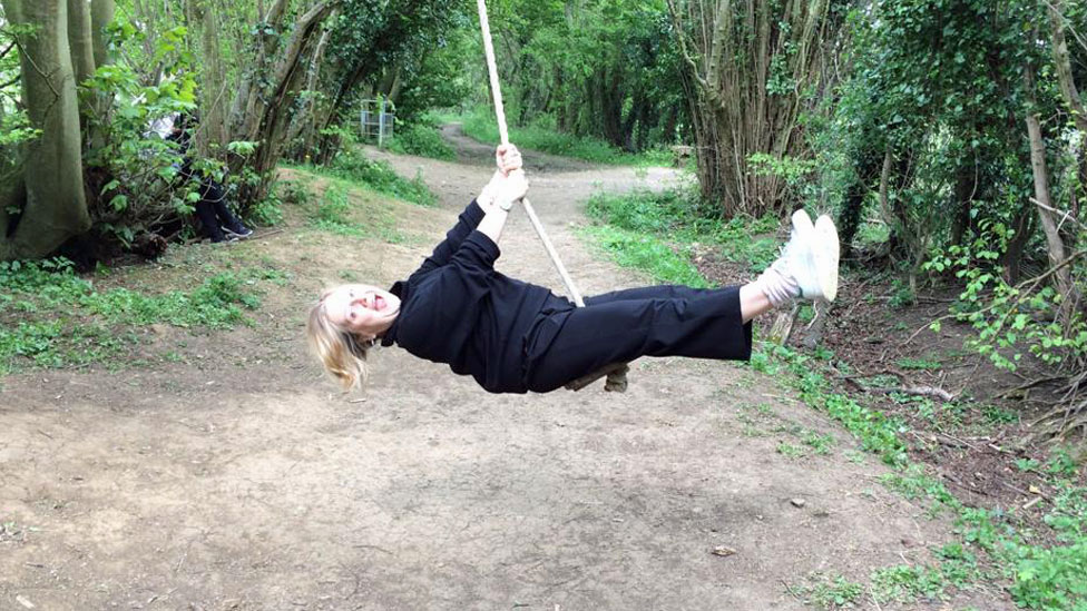 Sue on a swing in the forest