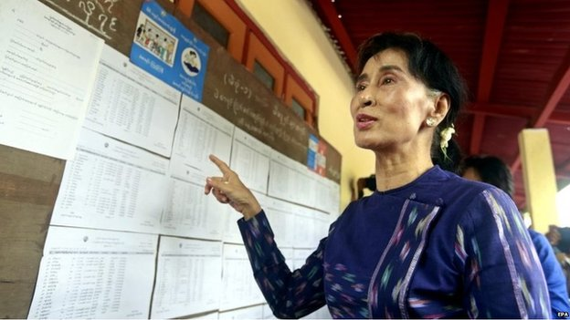 Myanmar opposition leader Aung San Suu Kyi talks to media as she checks the voters list at the Wahtheinkha village in Kawmhu township, Yangon, Myanmar