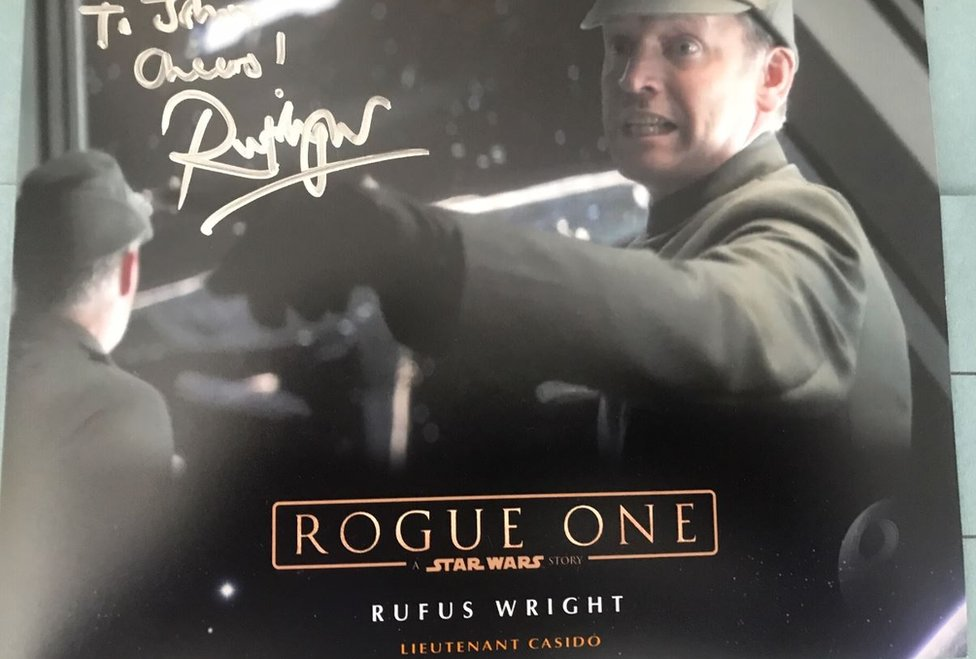 Signed publicity shot of actor Rufus Wright