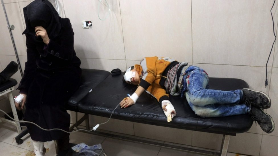 Wounded Syrians in a makeshift hospital in eastern Aleppo, 18 November