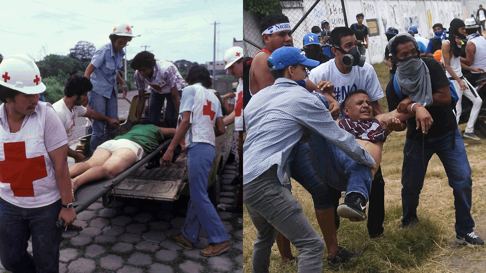 First aiders carry a person in 1979/Anti-government protesters help an injured partner during clashes within the 'Marcha de las Flores' in Managua, on June 30, 2018