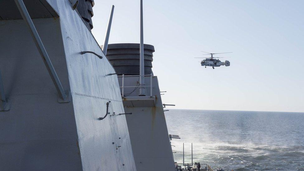 A Russian Kamov KA-27 Helix surveys USS Donald Cook on 12 April 2016
