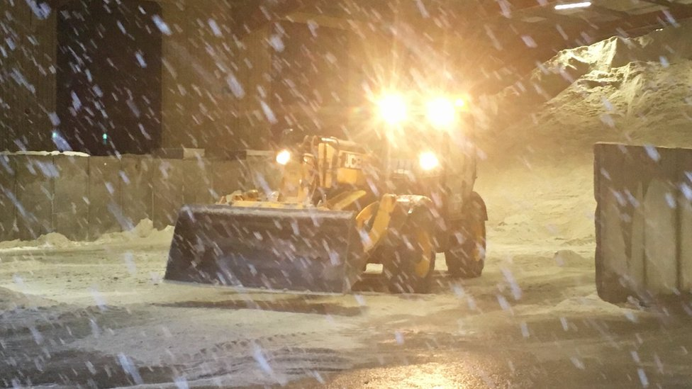 Snow falling at roads depot