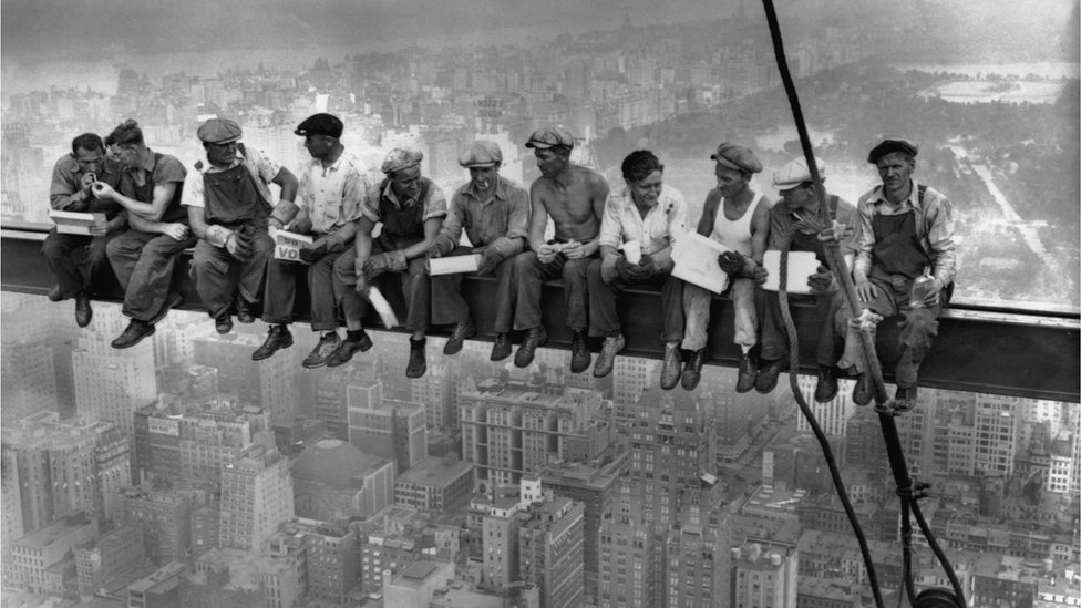 Iconic image showing construction workers eating their lunches on top of a steel beam (girder, crossbeam) 800 feet above ground, at the building site of the RCA Building in Rockefeller Centre