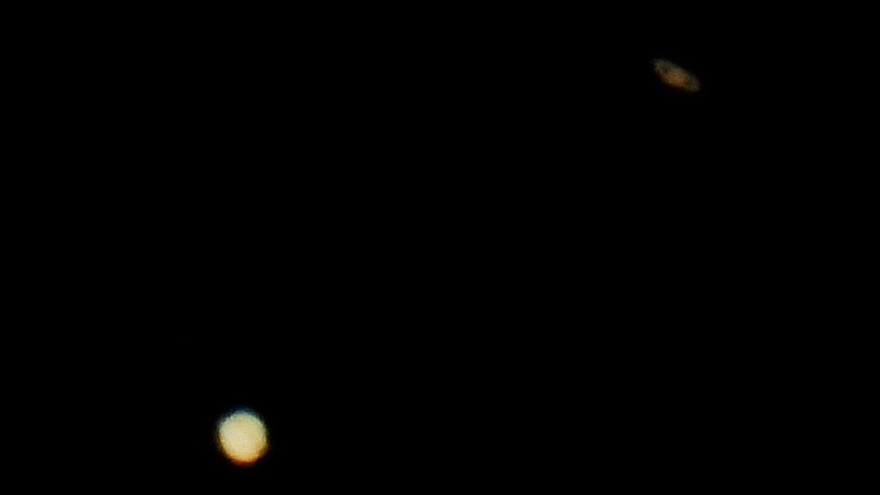 Jupiter (below) and Saturn (above)