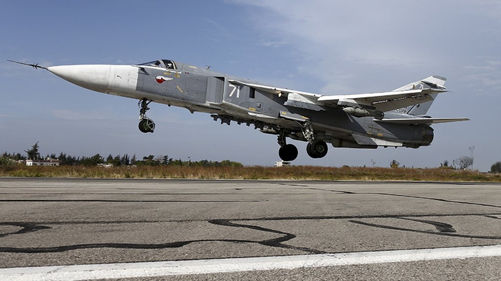 A Syrian Su-24 fighter jet taking off