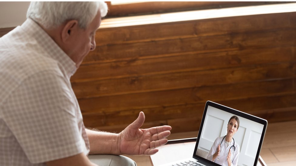 Elderly person talking to a doctor online
