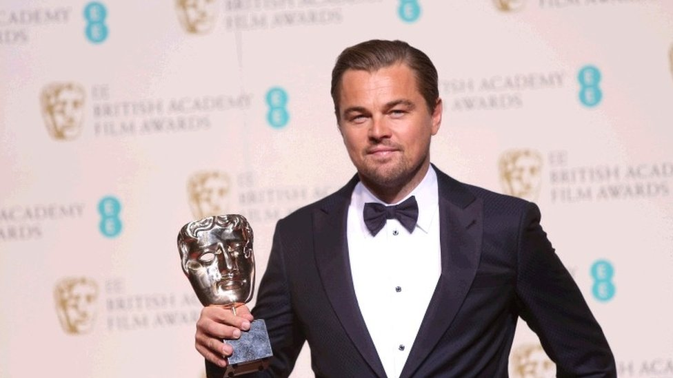 Actor Leonardo DiCaprio with his Best Actor award for his role in the film The Revenant backstage at the BAFTA 2016 film awards at the Royal Opera House in London, 14 February 2016