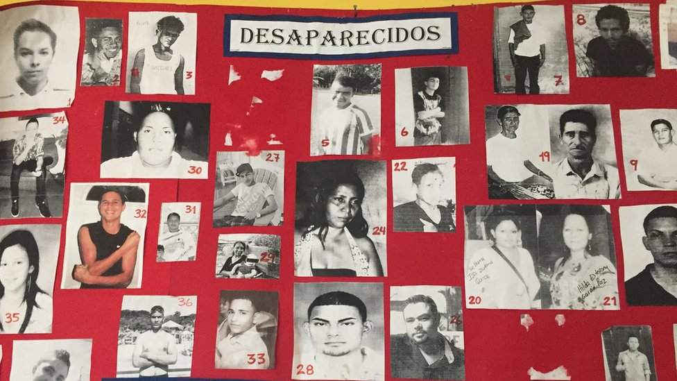 A poster listing missing people in a morgue in Honduras