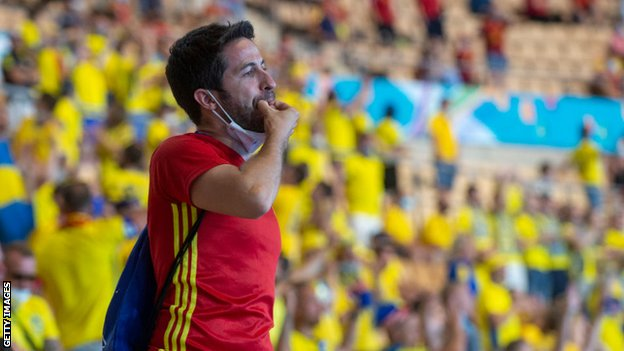 Spain fan whistles in the stands in Seville