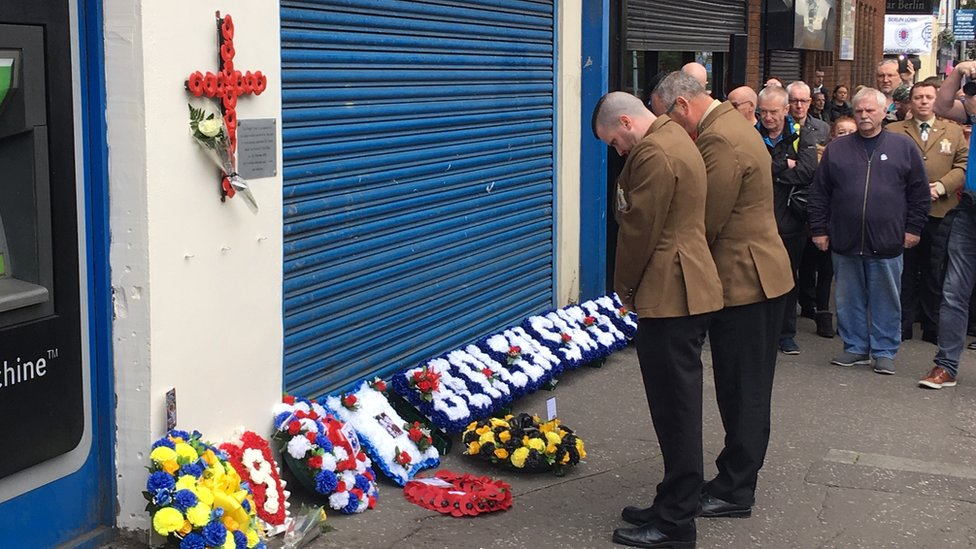 Wreaths laid outside Shankill bombing scene