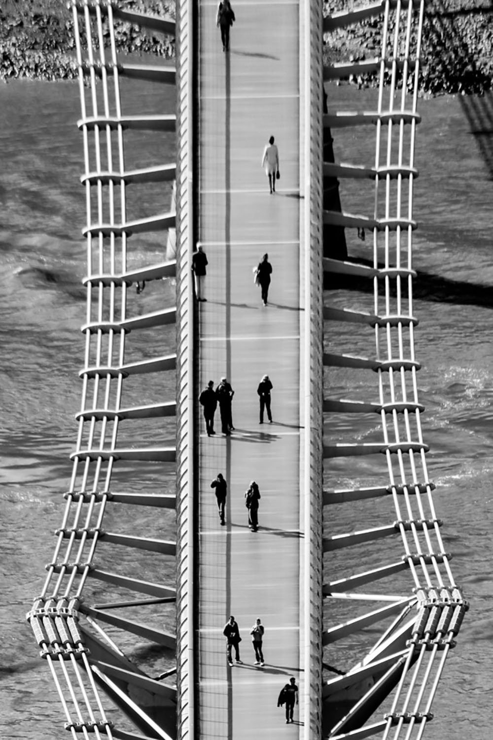 People walking across the Millennium Bridge