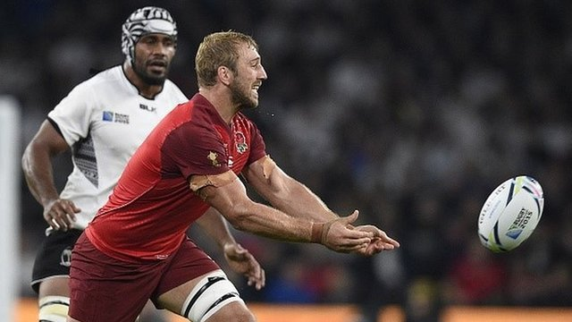 England's flanker and captain Chris Robshaw passes the ball during the opening game of the Rugby World Cup against Fiji