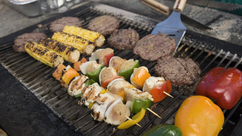 Burgers, kebabs and other foods on a barbecue