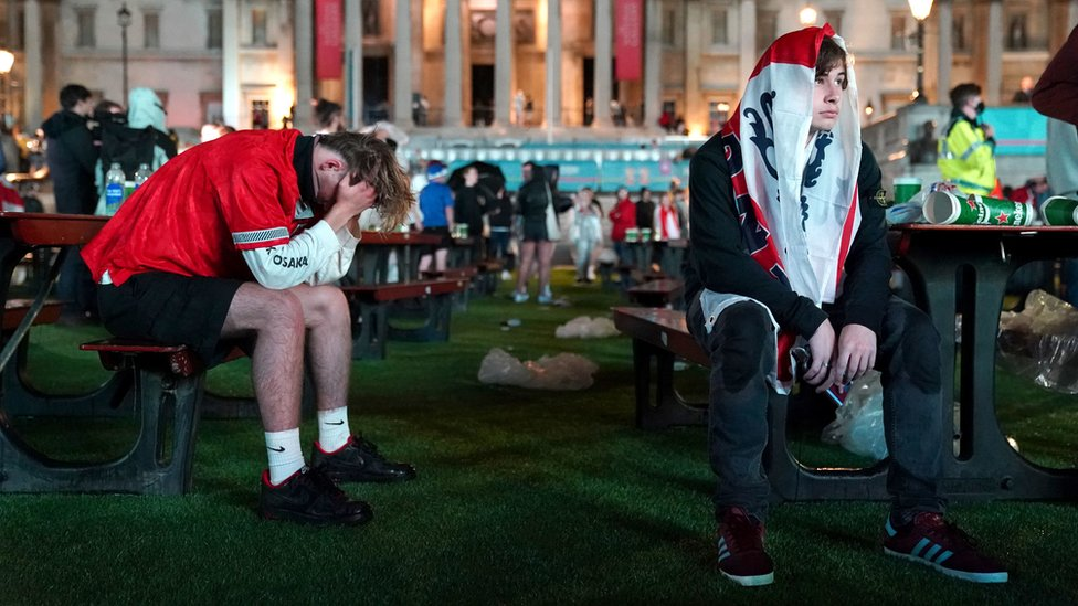 Fans after England lose the game on penalties at the Trafalgar Square Fan Zone in London