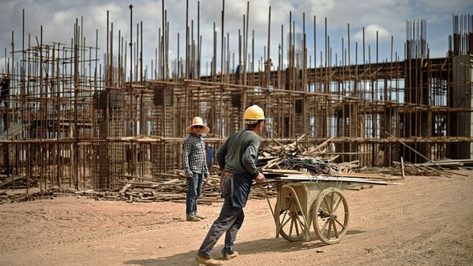 Chinese workers working on railway infrastructure on the new railway tracks linking Djibouti with Addis Ababa