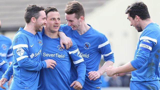 Ballinmallard players celebrate a vital victory over Warrenpoint Town at Ferney Park
