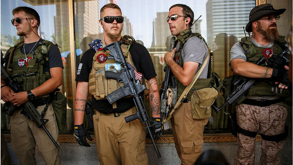 West Ohio Minutemen, an armed militia, stand guard near Public Square during the second day of the 2016 Republican National Convention in Cleveland, Ohio, on July 19, 2016.