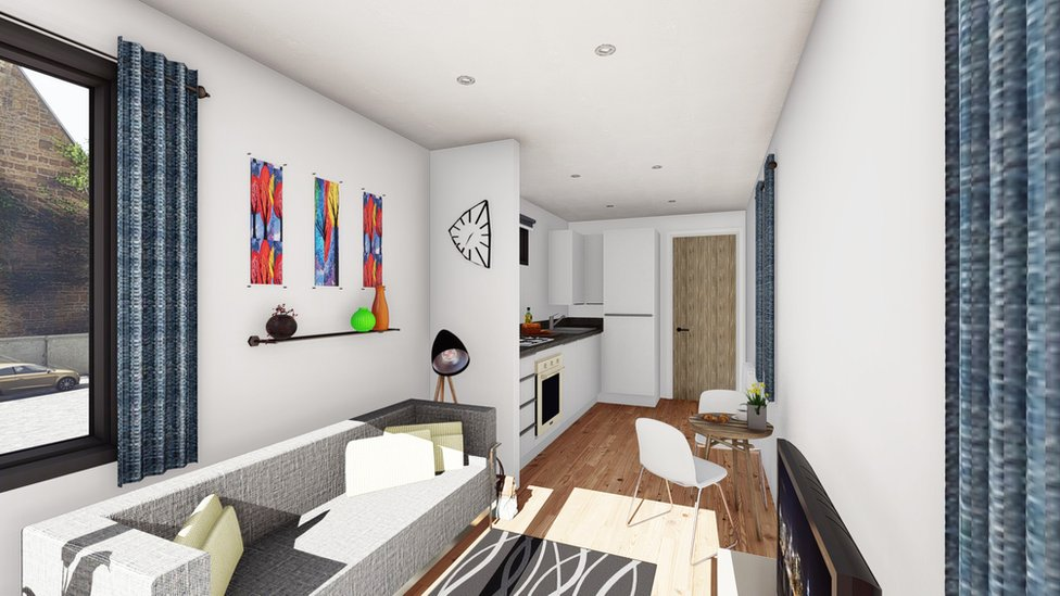 Artist impression of a living room in a converted shipping container