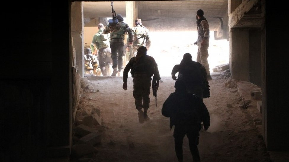 Rebel fighters from the Jaish al-Fatah (or Army of Conquest) brigades gather in position at an entrance to Aleppo, in the south-western frontline during a rebel offensive to break a three-month siege of the opposition-held east of Syria's second city (03 November 2016)