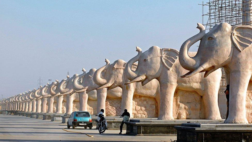 A row of stone elephants at a park in Uttar Pradesh.